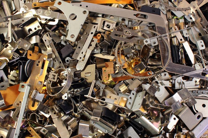 Pile of shiny metal parts. Scrap polished steel details. Abstract industrial background.  stock images