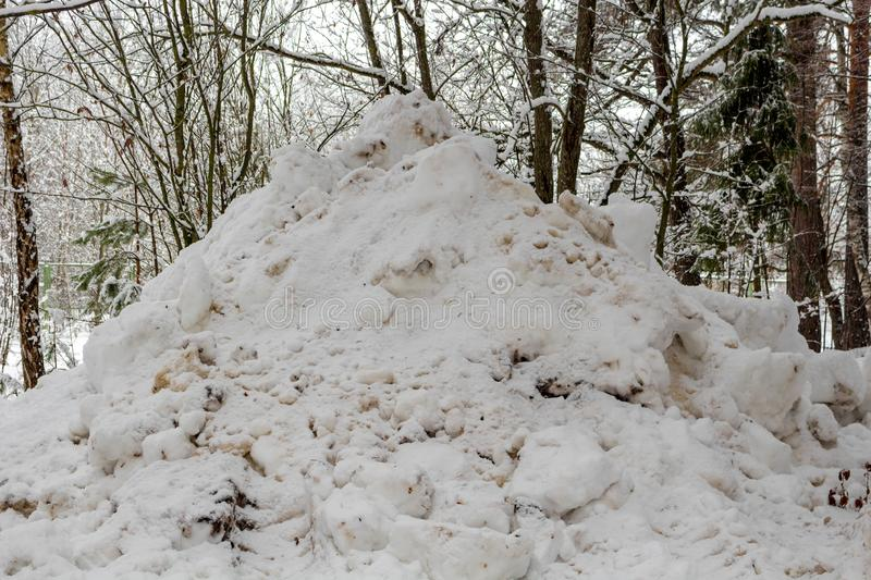 A pile of snow collected. By equipment from the road stock photo