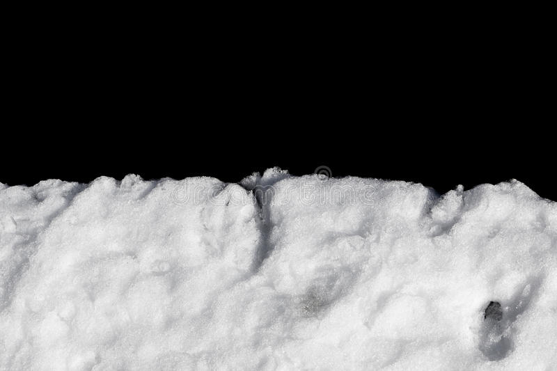 Pile of snow isolated on black stock photography