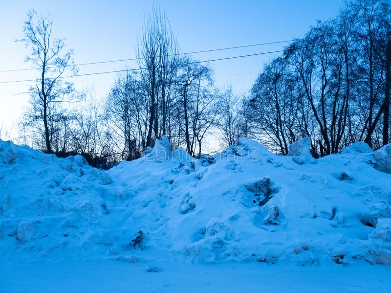 A pile of snow. A pile of dirty snow. Collected snow. Pile of snow. A pile of dirty snow. Collected snow royalty free stock image