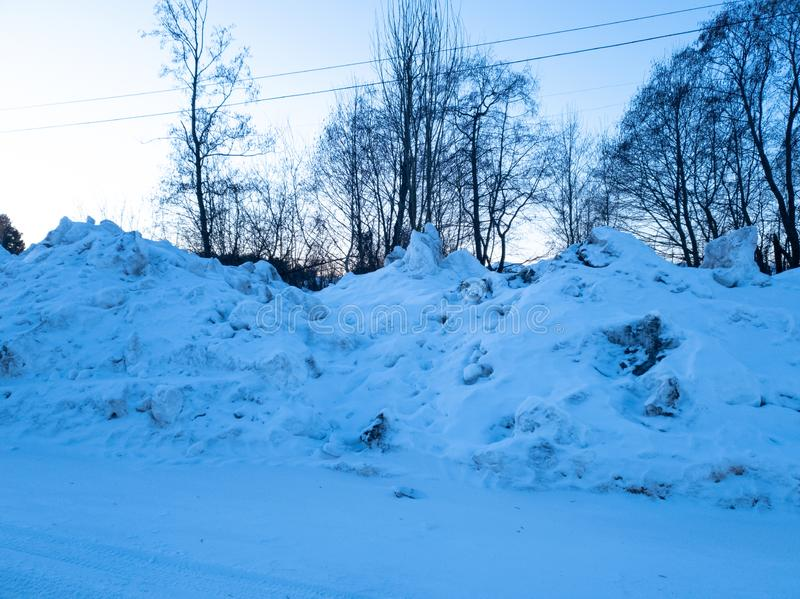 A pile of snow. A pile of dirty snow. Collected snow. Pile of snow. A pile of dirty snow. Collected snow stock photography