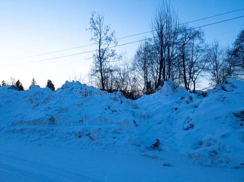 A pile of snow. A pile of dirty snow. Collected snow. Pile of snow. A pile of dirty snow. Collected snow stock photo