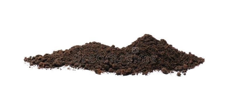 Pile of soil on white background. Fertile ground royalty free stock photos