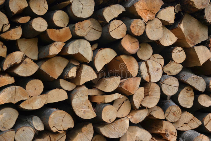 Pile of stacked firewood in rural garden ready for winter. Preparation for the winter. Wooden log abstract background. Dry chopped wood logs stock photos
