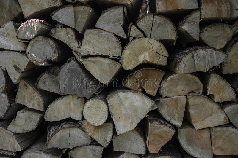 Pile of stacked firewood in rural garden ready for winter. Preparation for the winter. Wooden log abstract background royalty free stock photography