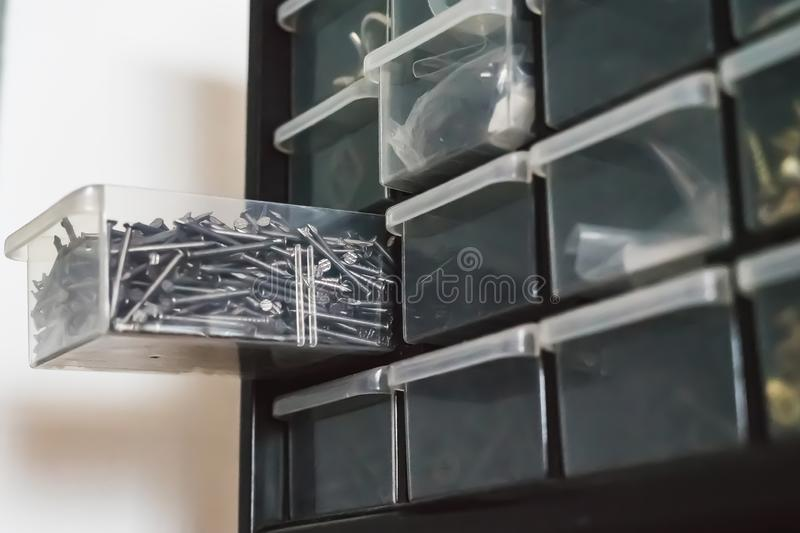 Pile of steel nails in the cubicle box in the drawer stock image