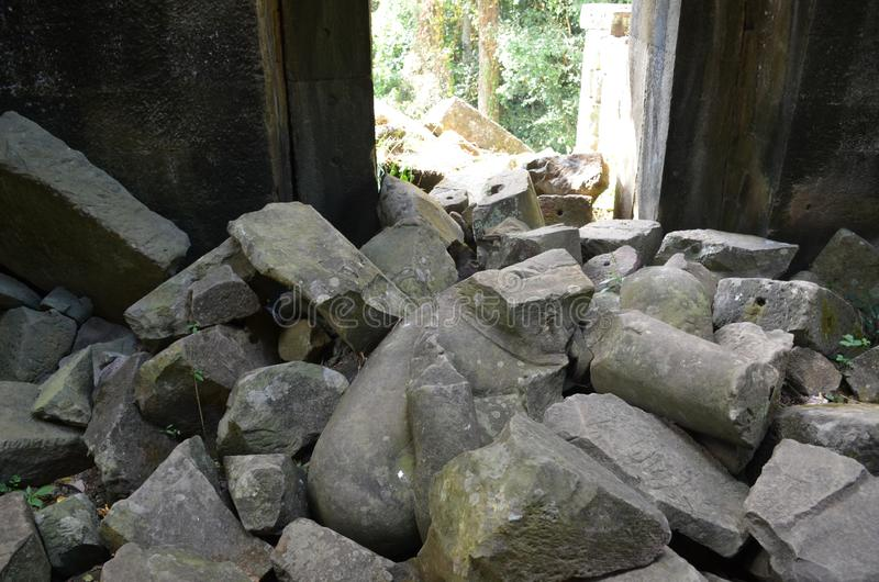 A pile of stones inside a temple destroyed by a bomb. Angkor, Cambodia stock photo