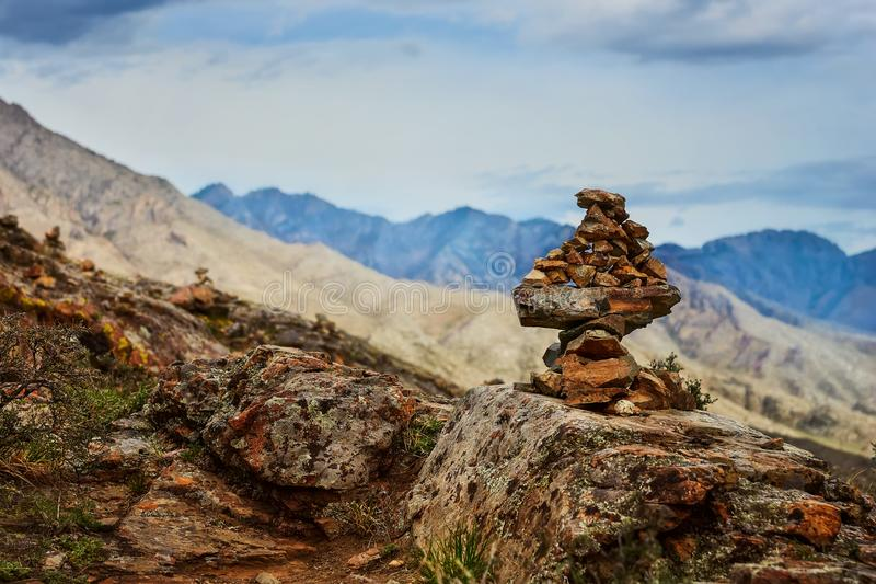 Pile of stones. Mysterious pile of stones in Altai mountains is a place of strength, energy & Zen. Close up of mystical sacred stone pyramid in Altay, Siberia royalty free stock image