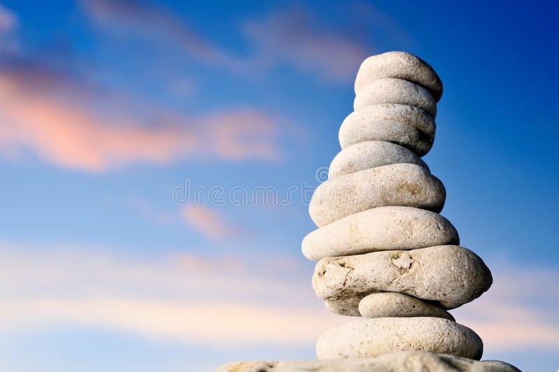 Pile of stones on seacoast stock image