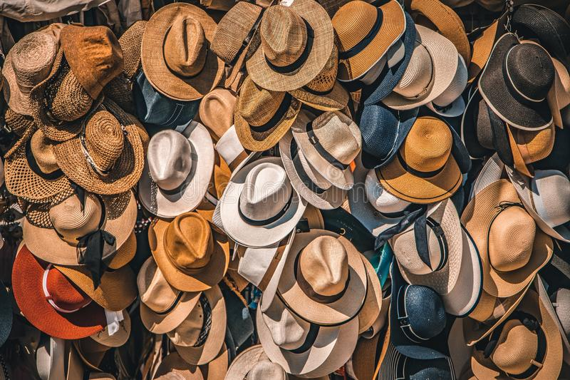 Pile of straw hats royalty free stock photography