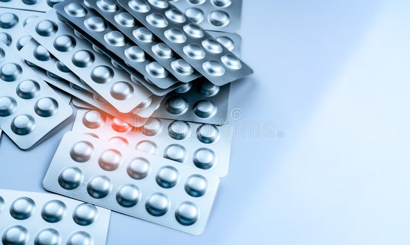 Pile of tablets pills in blister pack. Packaging in pharmaceutical industry. Pharmacy product. Drug selection to hospital. Global. Drug market concept. Pills royalty free stock photos
