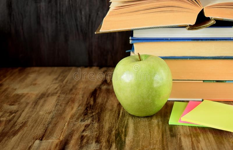 Pile Of Textbooks And A Green Apple Stock Photo - Image of ...