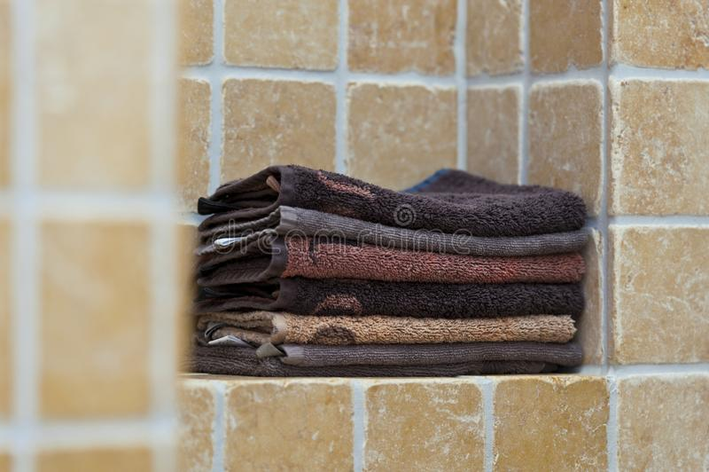 Pile of towels in bathroom royalty free stock images