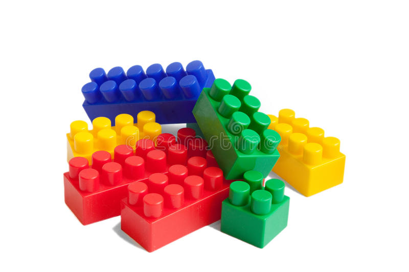 Pile of toy colorful blocks. A pile of colorful toy blocks isolated on white background royalty free stock image