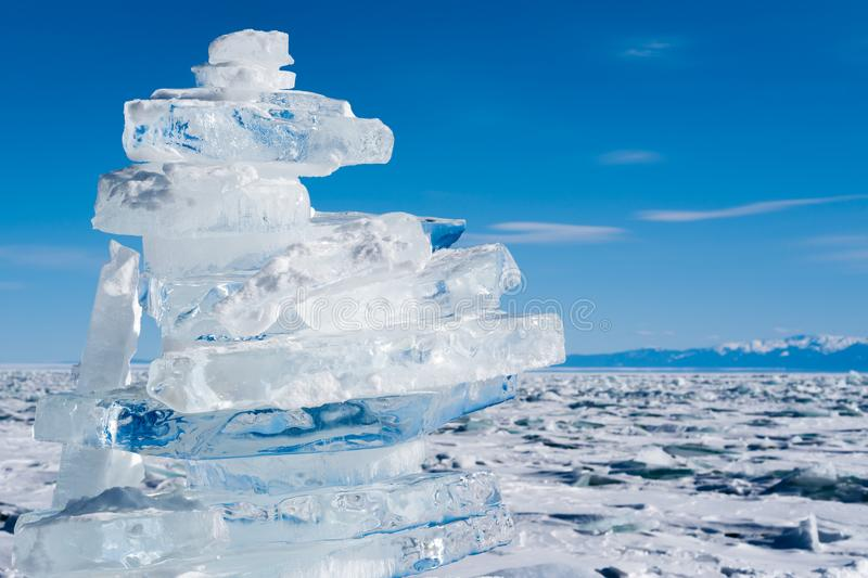 A pile of transparent ice floes on the surface of the frozen, largest fresh Lake Baikal in winter. Siberia. royalty free stock image