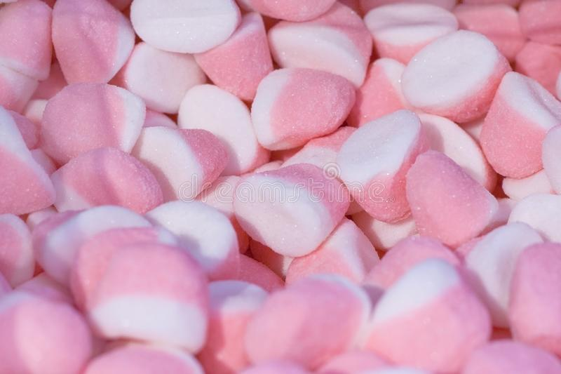 A pile of two-colored, pink-white candies royalty free stock images