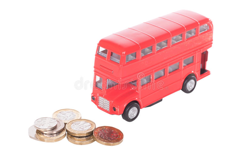 Pile of UK cash money with a model bus stock images