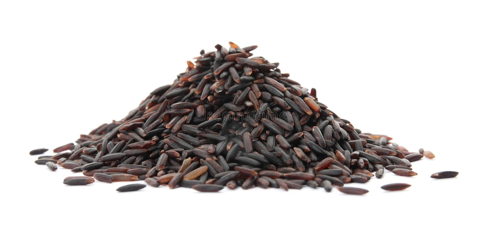 Pile of uncooked black rice stock photo
