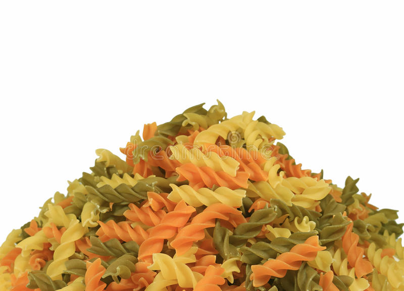 Pile of Uncooked Three-color Fusilli Pasta on White Background, Front View Photo with Free Space for Text. Or Design stock images
