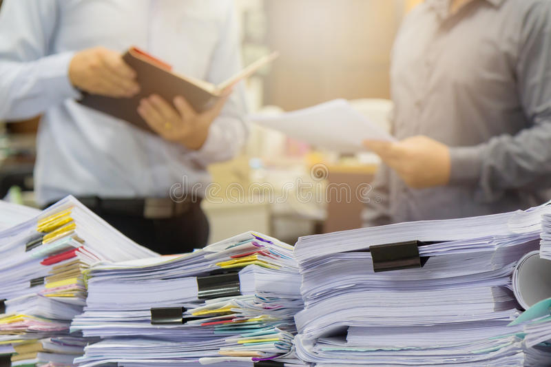 Pile of unfinished documents on office desk stock photography