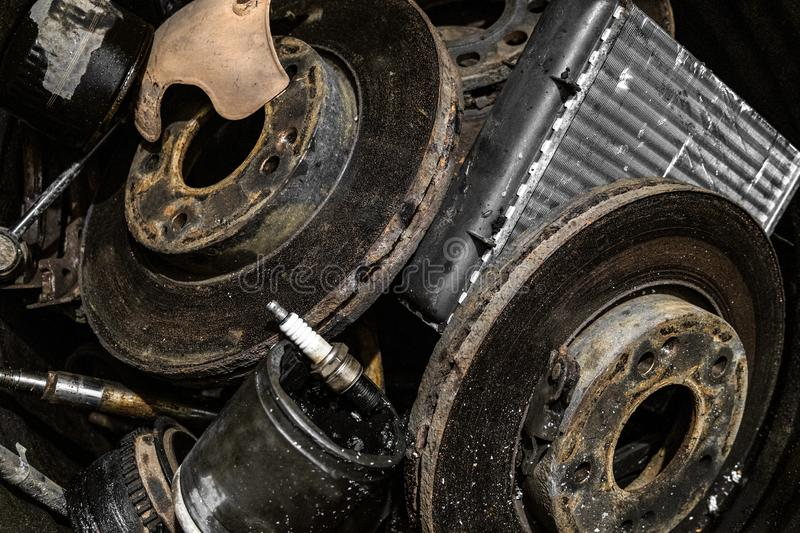 Pile of used automotive parts close-up royalty free stock photos