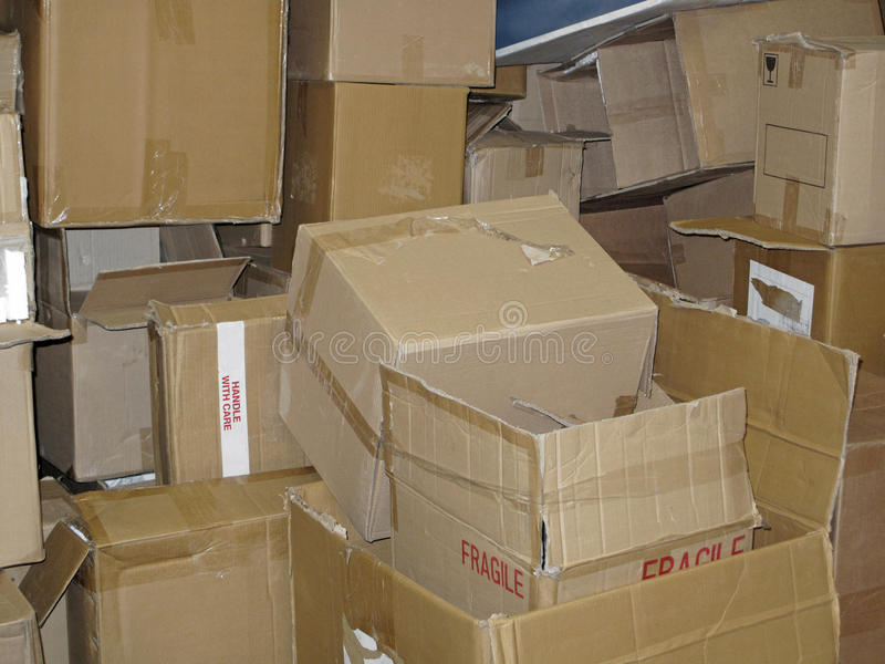 Pile of Used Cardboard Boxes. A stacked pile of various size emptied cardboard delivery boxes stock image