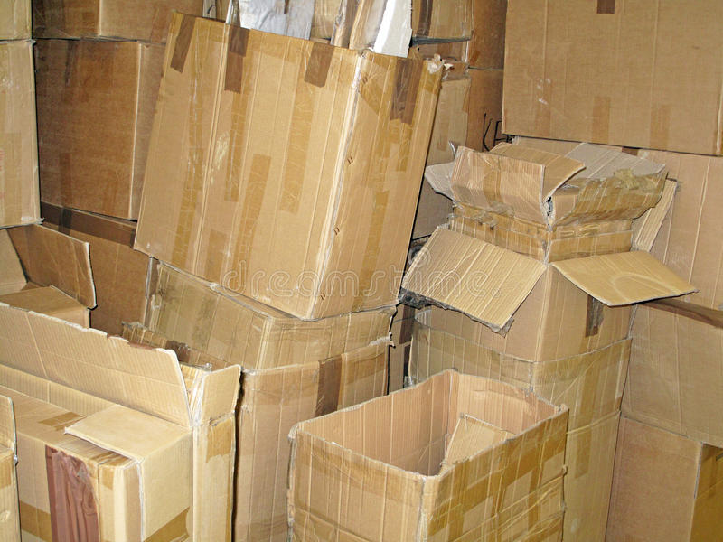 Pile of Used Cardboard Boxes. A stacked pile of various size emptied cardboard delivery boxes stock images