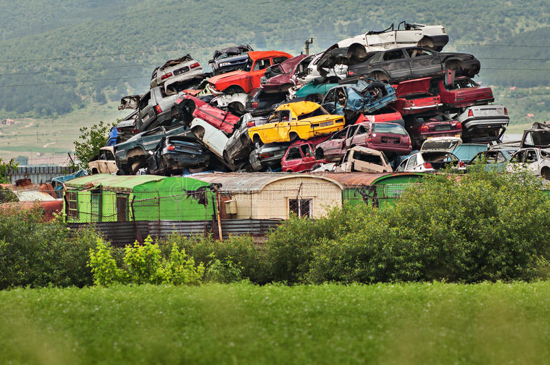 Pile of used cars in junkyard royalty free stock image