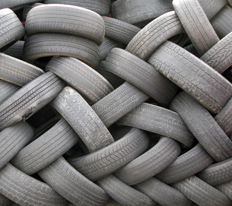 A Pile of Used Discarded Tires. stock photo
