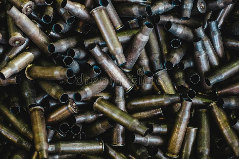 Pile of used rifle cartridges 7.62 mm caliber, many empty bullet shells, assault rifle bullet shell, military background, top view royalty free stock photo