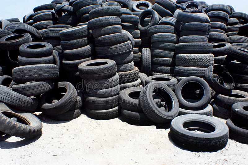 Pile of used rubber tyres stock photography