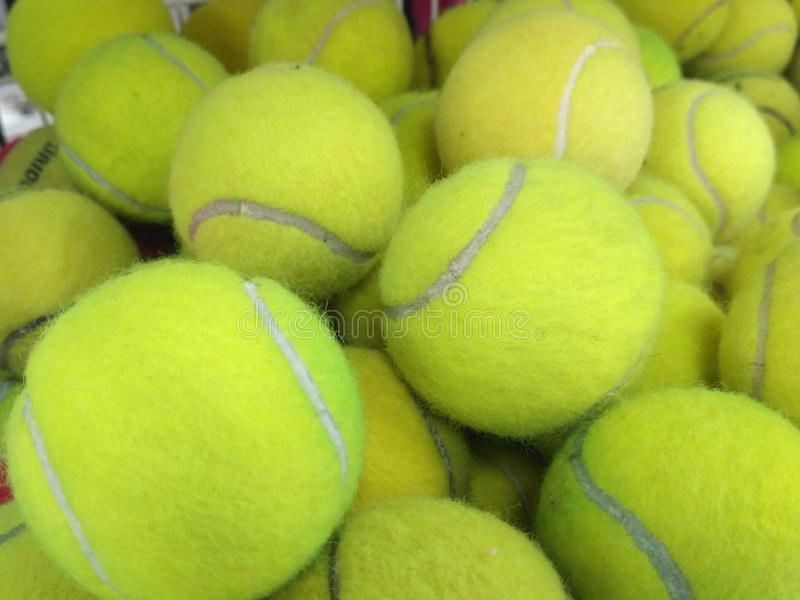 Pile of used tennis ball stock photo