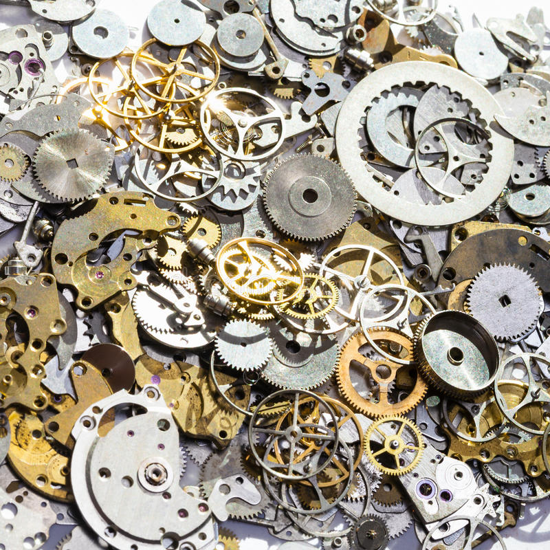 Pile of used watch spare parts close up royalty free stock images