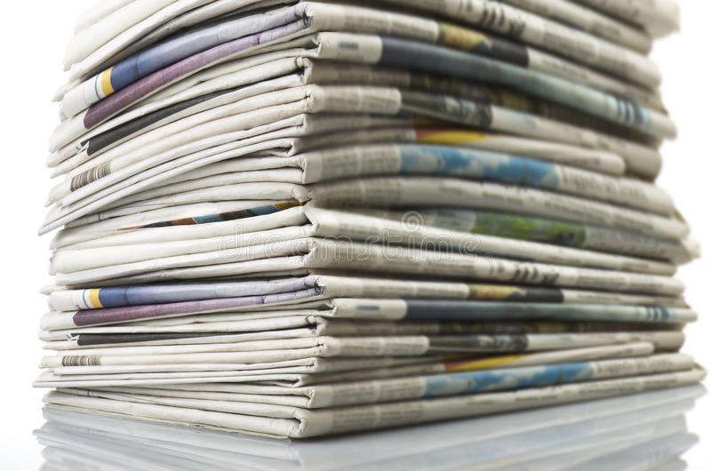 Pile of Various newspapers royalty free stock images
