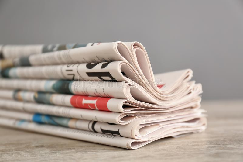 Pile of various newspapers on table royalty free stock photography
