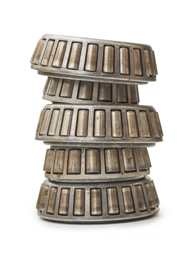 Pile of Various Stainless Roller Bearings, Isolated on White Background royalty free stock images