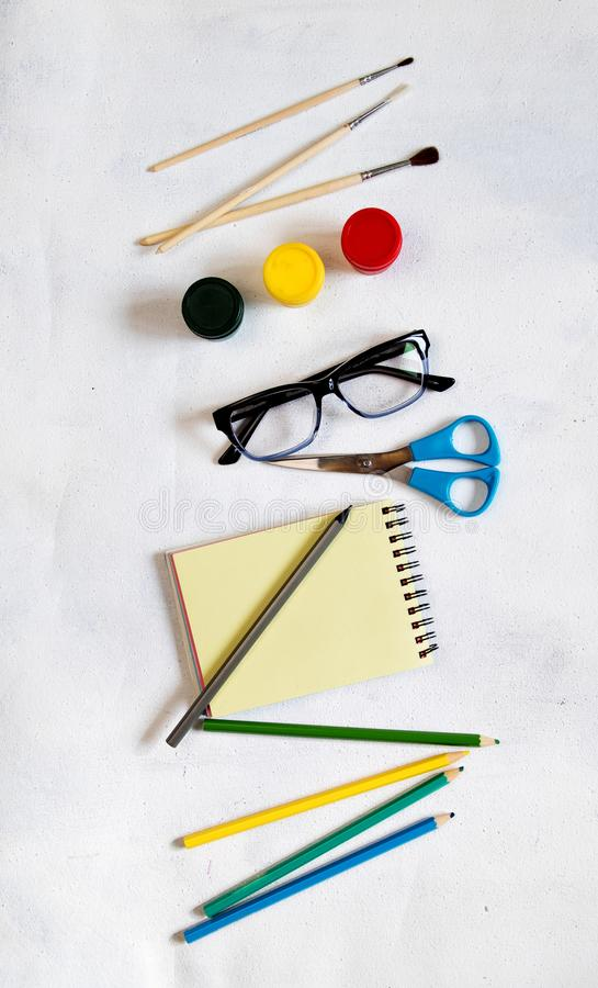 A pile of various stationery on table, notepad, colored pencils, ruler, marker, planer, space for text. Delicious school lunch box stock photo