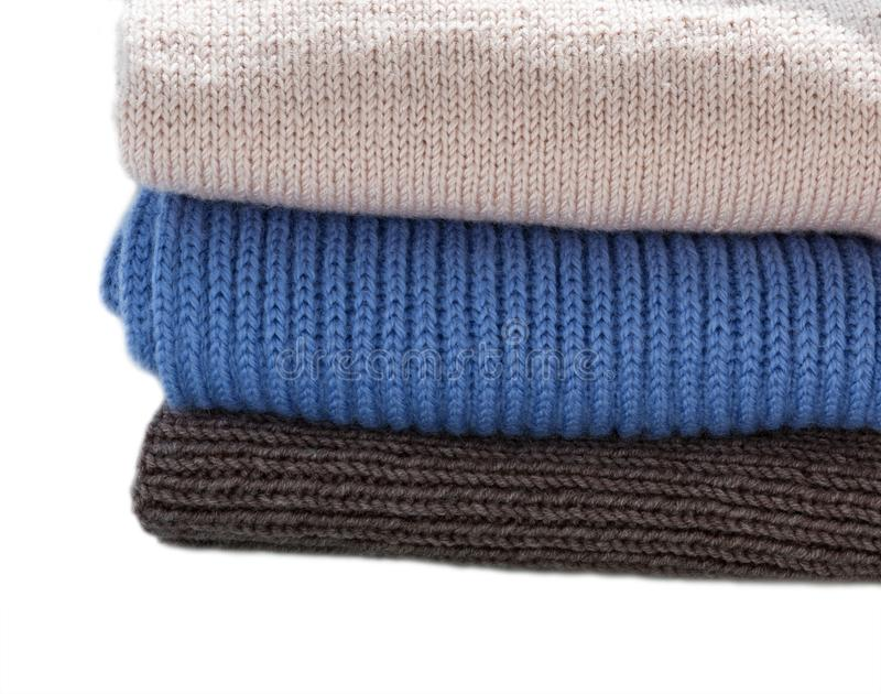 Pile of warm wool clothing. Closeup knitted texture royalty free stock image