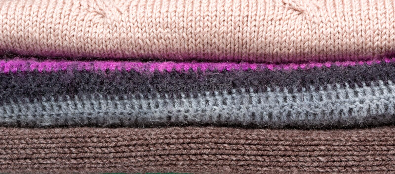 Pile of warm wool clothing. Closeup knitted texture stock image