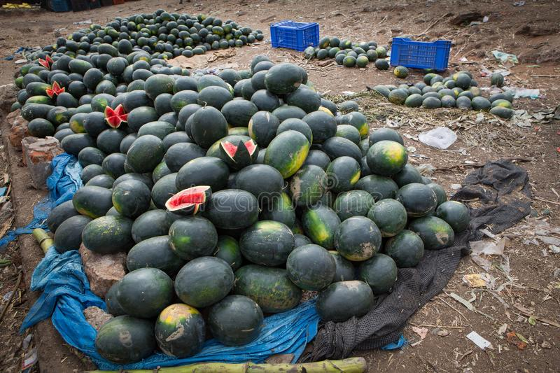 Pile of water melons at a roadside food market royalty free stock photo