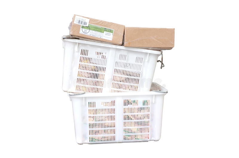 Pile of white plastic basket and paper box stock image