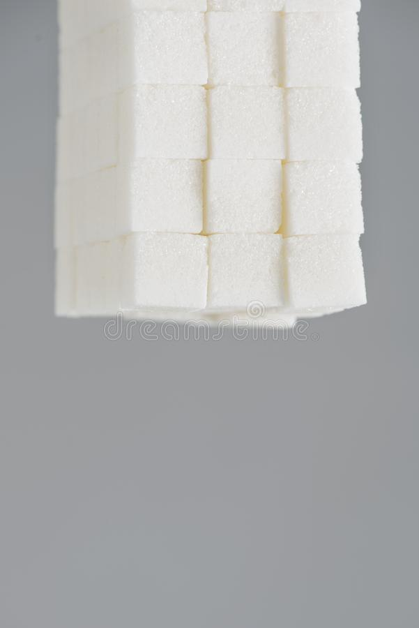 Pile of white sugar cubes royalty free stock image