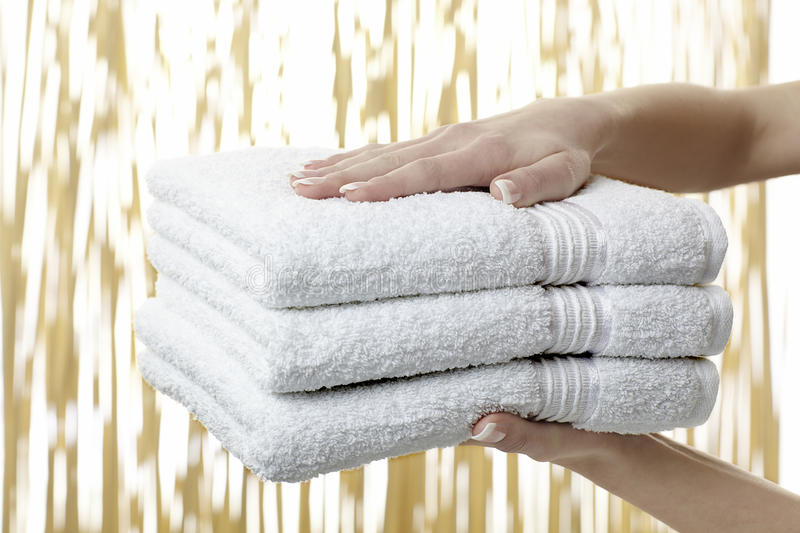 Pile of white towels stock images