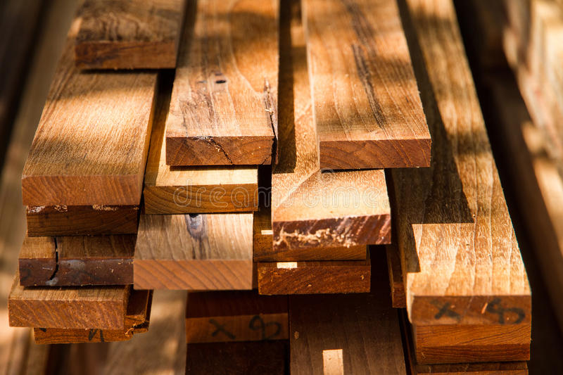 A pile of wood materials in wood processing factory. stock photo