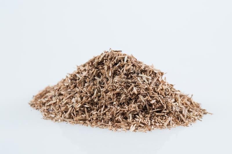 Pile of wood smoking chips isolated on white. stock image