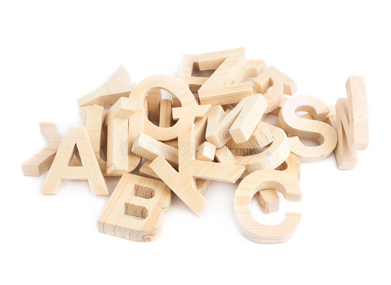 Pile of wooden block letters isolated. Pile of multiple wooden block letters isolated over the white background stock photos