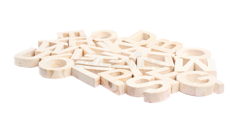 Pile of wooden block letters isolated. Pile of multiple wooden block letters isolated over the white background stock photography
