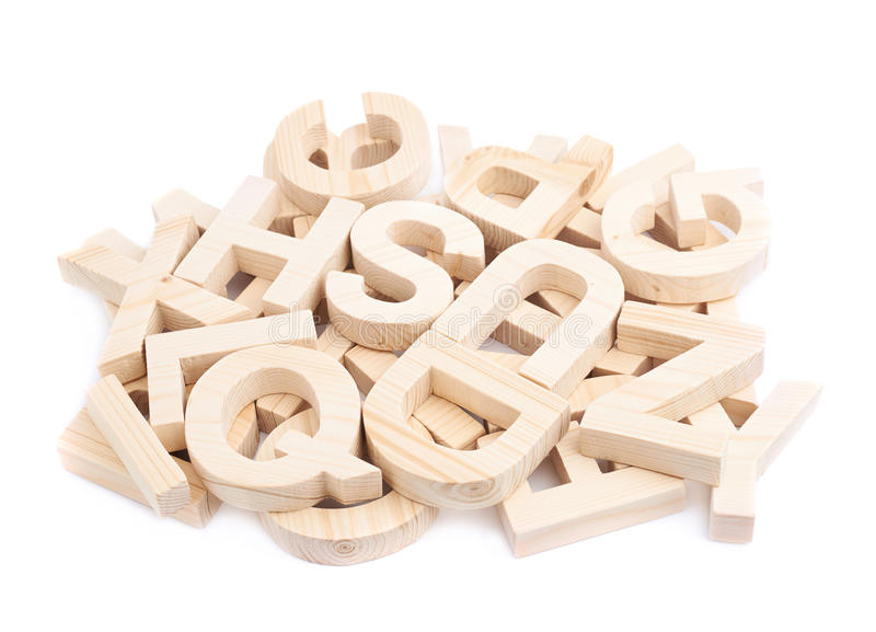 Pile of wooden block letters isolated stock image
