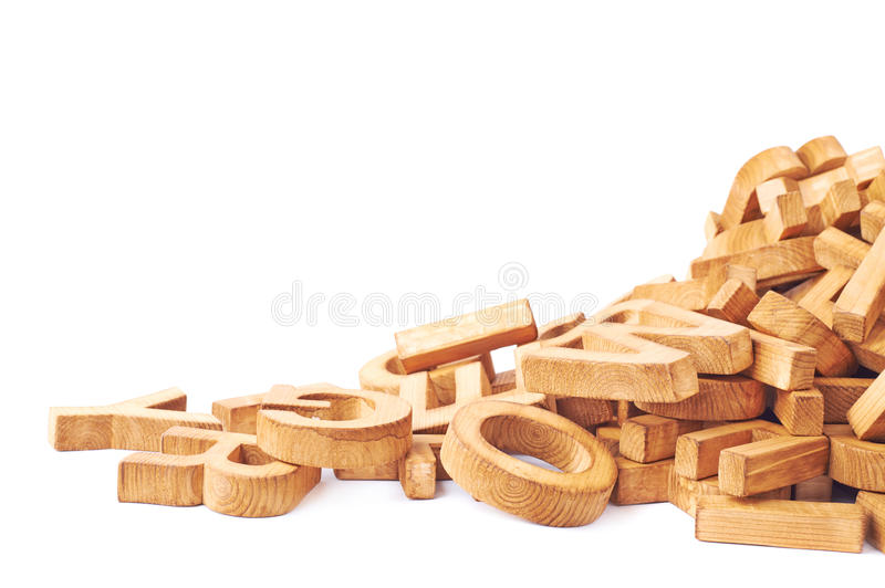 Pile of wooden block letters isolated. Over the white background as a typography background composition stock image