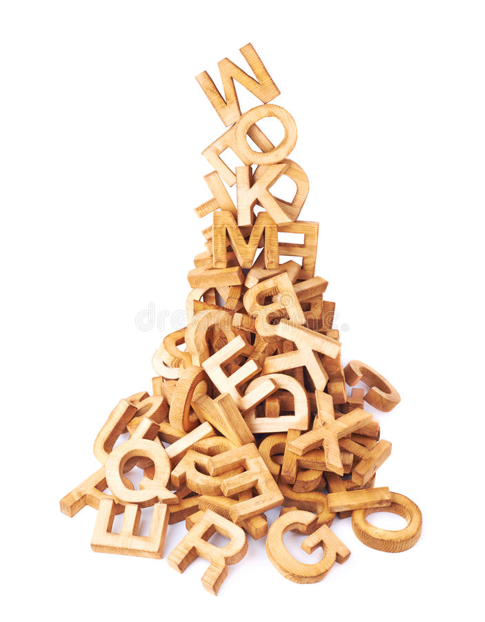 Pile of wooden block letters isolated. Over the white background as a typography background composition royalty free stock image